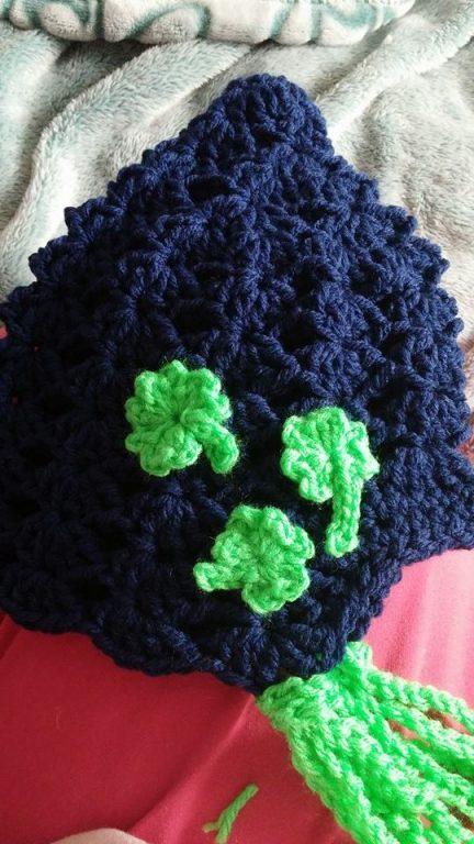 The Irish shamrock on a baby bonnet